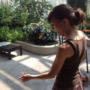 A butterfly lands on Sarah's hand at the Peggy Notebart Nature Museum in Lincoln Park, July 15, 2012