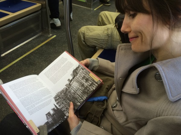 Sarah reading Paris book from Erik and Andrea
