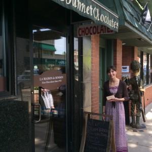 Sarah with a box of chocolates at La Maison de BonBon in Forest Park